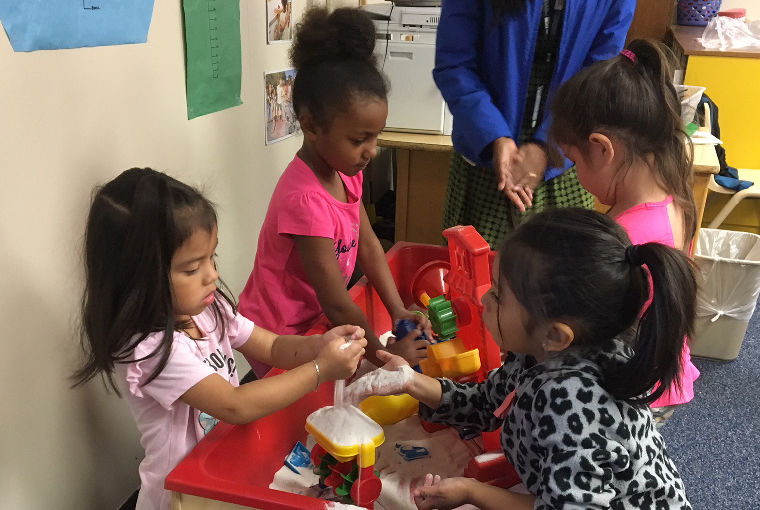 Preschool children playing and learning