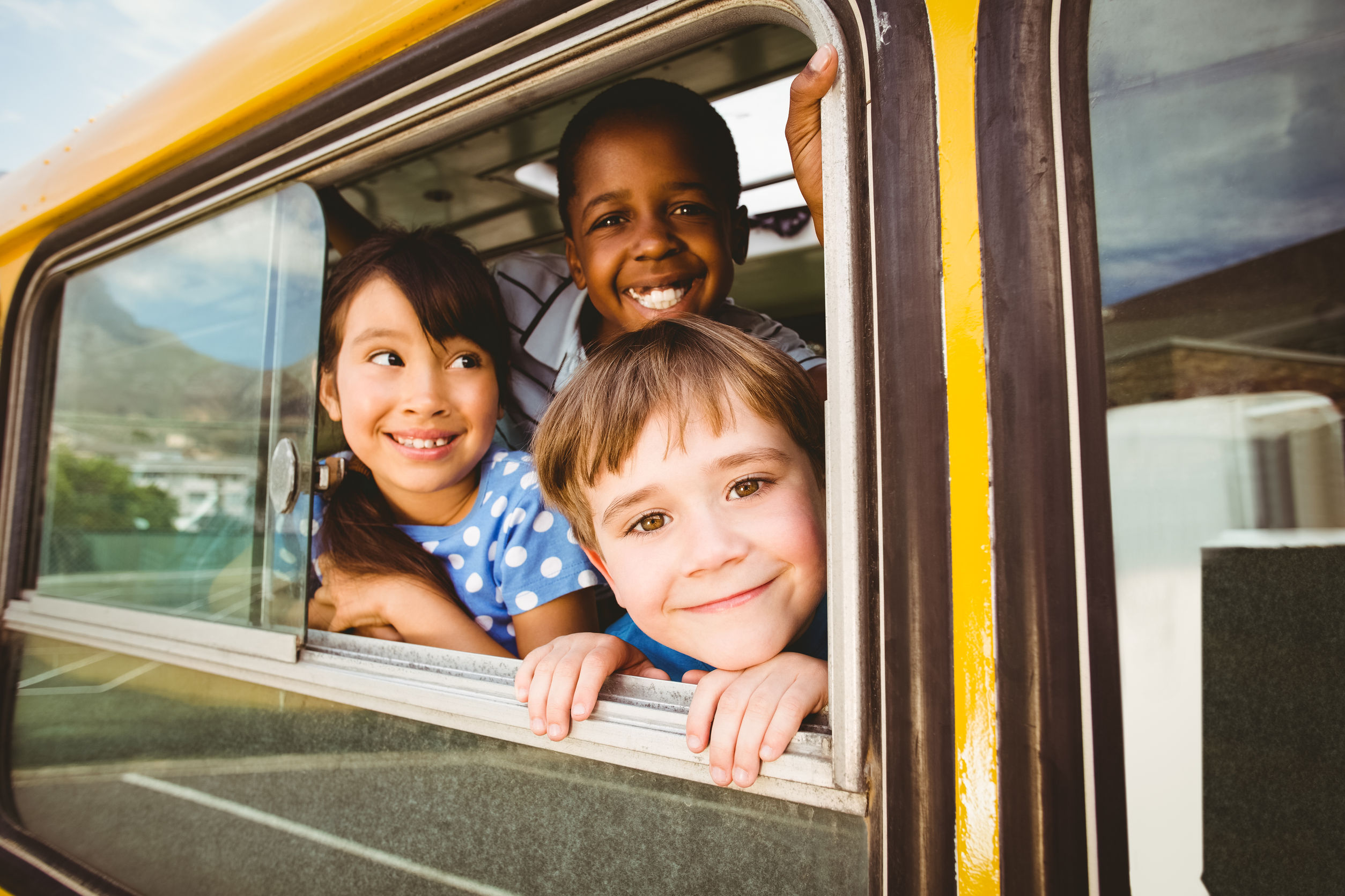cute kids on school bus
