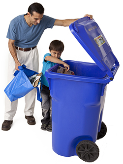 Man and boy recycling