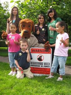 McGruff and kids give a thumbs up to Neighborhood Watch