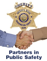 Partners in Public Safety - hands shake under Sheriff's star