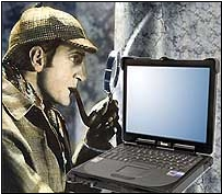 Sherlock Holmes finds a clue on a laptop