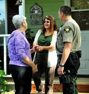 Elder Safe - Marcia and deputy meet with elder citizen