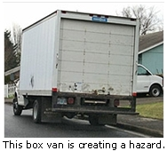 This large box van creates a safety hazard for those backing out of driveways.